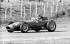 Mike Hawthorn (1922-1959), coureur automobile anglais, au volant d'une Lancia Ferrari, lors du Grand Prix d'Italie de 1957. © Alinari / Roger-Viollet