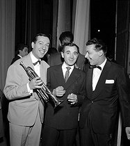 Jo Bouillon (1908-1984), French composer, conductor and violinist, Charles Aznavour (1924-2018), Armenian-born French singer-songwriter and actor, and Georges Jouvin (1923-2016), French trumpeter and composer. © Claude Poirier / Roger-Viollet