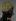 Bonnet, par Suzanne Talbot, satin de soie verte brodé de motifs floraux en fils d'or et en fils de soie jaune et rouge, vers 1920-25. Paris, musée Galliera. © Stéphane Piera/Galliera/Roger-Viollet