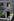 Femme à sa porte à la villa de l'Ermitage à Belleville. Paris (XXème arr.), juin 1967. Photographie de Léon Claude Vénézia (1941-2013). © Léon Claude Vénézia/Roger-Viollet