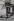 Through the streets of Paris. Jacky (Audrey Hepburn's double), Givenchy model, in Montmartre, rue de l'Abreuvoir. Paris (XVIIIth arrondissement), 1956. Photograph by Jean Marquis (born in 1926). Bibliothèque historique de la Ville de Paris. © Jean Marquis / BHVP / Roger-Viollet