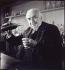 """""""Louis Lumière and a test tube"""", photograph by Walter Limot (1902-1984). Paris, musée Carnavalet. © Walter Limot / Musée Carnavalet / Roger-Viollet"""