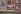 Guerre 1939-1945. Affiches de propagande, Champs-Élysées. Paris, 1943. Photographie d'André Zucca (1897-1973), couleurs d'origine restaurées. Bibliothèque historique de la Ville de Paris. © André Zucca / BHVP / Roger-Viollet