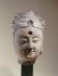 """""""Tête de Bouddha"""". Chine, époque des Qi (479-502). Paris, musée Cernuschi. © Musée Cernuschi/Roger-Viollet"""