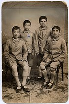 Missak Manouchian (sitting on the left, 1906-1944), Armenian poet and resistance fighter, with his brother, Karapet Manouchian (his right hand on his shoulder), at the orphanage. © Archives Manouchian / Roger-Viollet