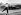 Stirling Moss (né en 1929), pilote automobile britannique, remportant le Grand Prix de Monsanto. Lisbonne (Portugal), 25 août 1959. © TopFoto/Roger-Viollet