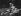 """Couple en maillot de bain, allongés sur la pelouse, 1936. Photographie d'Imre von Santho (1900-1946), publiée dans le magazine """"Die Dame"""". © Imre von Santho/Ullstein Bild/Roger-Viollet"""
