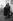 Couple de passants, rue Gît-le-Coeur. Paris (VIème arr.), 1960. Photographie d'Harold Chapman (né en 1927). © Harold Chapman/TopFoto/Roger-Viollet