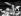 """Albert Uderzo (né en 1927), dessinateur franco-italien et scénariste d'""""Astérix et Obélix"""", tenant les figurines des héros, 1987. © Ullstein Bild/Roger-Viollet"""