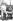 Jack Ashley (1922-2012), homme politique britannique, entouré de deux enfants aveugles de 7ans, tenant des livres prototypes en braille, 7 avril 1987. © TopFoto/Roger-Viollet