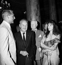 Cary Grant, Darryl F. Zanuck and Juliette Gréco. Cannes Film Festival, 1959.    © Roger-Viollet