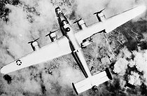 "World War II. American bomber Consolidated B-24 ""Liberator"" touched at the wing. © Roger-Viollet"