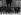 Le général De Gaulle, président de la République française, recevant une délégation de mères de familles méritantes lors de la fête des Mères. Paris, palais de l'Elysée, 27 mai 1961. © Roger-Viollet