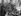 Anschluss. Soldat allemand en discussion avec des autrichiens lors de l'entrée des troupes allemandes de la Wehrmacht en Autriche, 12 mars 1938.  © Ullstein Bild / Roger-Viollet