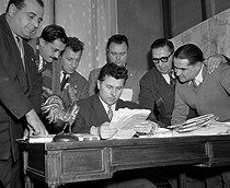 Pierre Poujade (1920-2003), French politician and his staff. January 6, 1956. © Roger-Viollet