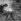 Camper lighting a fire. © Gaston Paris / Roger-Viollet