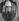 Chute du mur de Berlin. Vue sur le Reichstag à travers un trou du mur. Allemagne, 1990. © Ullstein Bild / Roger-Viollet