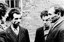 World War II. Missak Manouchian (second on the left) and two members of his group of Resistance fighters (Wasjbrot and Boczov), photographed by the German propaganda, shortly before their execution, February 1944. © Roger-Viollet