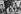 """Anne Tonglet (au centre) victime de viol entre Gisèle Halimi (à droite) et Mme Chevalier (à gauche), à l'Assemblée Générale de """"Choisir"""". Le procès de ses agresseurs fait date puisque le viol est définitivement reconnu comme crime. Procès défendu et gagné par Gisèle Halimi. Paris, 25 juin 1978. Photographie de Janine Niepce (1921-2007). © Janine Niepce / Roger-Viollet"""