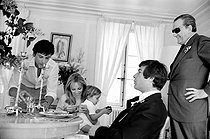 Christening of Anthony Delon, Alain Delon and Nathalie's son, with Jean-Claude Brialy and Luchino Visconti. on May 1st, 1966. Photograph by Georges Kelaïditès (1932-2015). © Georges Kelaïditès / Roger-Viollet
