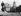 Immeubles et gratte-ciel vus de Battery Park, à la pointe sud de Manhattan. À droite l'immeuble de la Standard Oil Company. New-York (États-Unis), 1935.  © Collection Roger-Viollet / Roger-Viollet