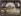 Under the Eiffel Tower. Paris (VIIth arrondissement), circa 1910. Autochrome. Photograph by Jules Gervais-Courtellemont (1863-1931). Cinémathèque Robert-Lynen, Ville de Paris. © Cinémathèque Robert-Lynen/Roger-Viollet