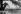 """Alain Delon (né en 1935), acteur français, sur le tournage de """"La piscine"""" de Jacques Deray. 1968. Photographie de Georges Kelaïditès (1932-2015). © Georges Kelaïditès / Roger-Viollet"""