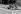 Bronzage sur les quais de la Seine. Paris, juillet 1952.      © Roger-Viollet