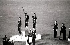 """Jeux olympiques de Mexico. Podium du 200 mètres masculin, de g. à dr. : Peter Norman (Australie, 2ème), Tommie Smith et John Carlos (Etats-Unis, respectivement 1er et 3ème, faisant le signe du """"Black Power""""), 16 octobre 1968. © TopFoto / Roger-Viollet"""