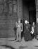 Mohammed Reza Pahlavi (1919-1980), shah d'Iran, visitant la cathédrale Notre-Dame de Paris avec l'archiprêtre Rabecque. 2 août 1948. © Roger-Viollet