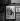 """Guerre 1939-1945. Libération de Paris. Affiche de Paul Colin (1892-1985) : """"En l'honneur de Paris - Hommage a ceux qui l'ont délivrée"""", collée sur les murs, pour annoncer une cérémonie organisée par le Journal Libération et tenue au Palais de Chaillot le 11 novembre 1944. Paris (XVIème arr.), 1944. Photographie de Jean Roubier (1896-1981). © Fonds Jean Roubier/Roger-Vio"""