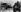 Guerre 1939-1945. Bataille des Ardennes. Progression d'une division de chars de l'armée allemande. Sur la gauche : les ruines d'un char de l'armée américaine, 12-20 décembre 1944. © Ullstein Bild / Roger-Viollet