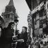 Newspaper seller. Paris, 1950's. Photograph by Janine Niepce (1921-2007). © Janine Niepce / Roger-Viollet