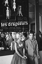 "Nicole Berger (1934-1967), French actress, and Charles Aznavour (1924-2018), Armenian-born French singer-songwriter and actor, attending the premiere of ""Les Dragueurs"", film by Jean-Pierre Mocky, 1959. © Noa / Roger-Viollet"