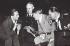 """""""L'opinion allemande s'inquiète. Dr. Goebbels après tout qu'est ce qu'on risque? Notre argent est à l'étranger... Si ça se gâte, nous n'aurons qu'à filer"""". Photomontage de Jacob Marinus Kjeldgaard.   © Alinari/Roger-Viollet"""
