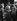 Guerre 1939-1945. Le voyage du Führer en Italie. Benito Mussolini (1883-1945), homme d'Etat italien, et le roi Victor-Emmanuel III d'Italie (1869-1947), saluant Adolf Hitler (1889-1945), homme d'Etat allemand, à la gare de Rome (Italie), 3-9 mai 1938. © Alinari / Roger-Viollet