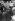Anschluss. Passants regardant la carte du Troisième Reich après l'entrée des troupes de la Wehrmacht en Autriche. Berlin, 15 avril 1938. © Ullstein Bild / Roger-Viollet