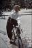 World War II. Woman with her bicycle.  Cours de Vincennes. Paris, 1941. Photograph by André Zucca (1897-1973). Bibliothèque historique de la Ville de Paris. © André Zucca/BHVP/Roger-Viollet
