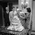 """Jean-Pierre Melville, Jean-Paul Belmondo, Charles Vanel et Michèle Mercier à la fin du tournage de """"L'Ainé des Ferchaux"""". Septembre 1962.      © Alain Adler / Roger-Viollet"""