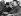 """Conférence de Munich. Le premier ministre français Edouard Daladier (à gauche), et le ministre des Affaires Etrangères allemand Joachim von Ribbentrop (à droite), en route pour l'hôtel """"Vier Jahreszeiten"""". Munich, 29 septembre 1938. © Ullstein Bild/Roger-Viollet"""