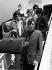"""Keith Richards, Mick Jagger, Mick Taylor et Bill Wyman, chanteur du groupe de rock anglais """"The Rolling Stones"""", en partance pour les Etats-Unis. Londres (Angleterre), aéroport d'Heathrow, 23 juin 1966. © PA Archive / Roger-Viollet"""