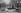 Crue de la Seine. Sauveteur secourant une famille, quai des Grands-Augustins. Paris (VIème arr.), janvier 1910. © Neurdein/Roger-Viollet