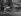 Hélène Roger-Viollet (1901-1985), French photographer, holding an umbrella on a bicycle, boulevard Saint-Michel. Paris, 1937. © Roger-Viollet