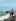 """Cuba. Baie des Cochons (Playa Girón), tentative de débarquement encouragée par la CIA. 15 avril 1961. Soldat cubain posant devant une barge de débarquement (photomontage). Illustration pour la revue """"Bohemia"""".     GLA-BFC-P104 © Gilberto Ante/BFC/Gilberto Ante/Roger-Viollet"""