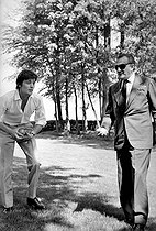 Alain Delon (born in 1935), French actor, and Luchino Visconti (1906-1976), Italian writer, scriptwriter and director, playing petanque on the day of Anthony Delon's christening, on May 1st, 1966. Photograph by Georges Kelaïditès (1932-2015). © Georges Kelaïditès / Roger-Viollet