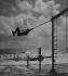 Swing. La Baule (France), 1936. © Pierre Jahan / Roger-Viollet