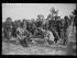 "Spanish Civil War (1936-1939). ""La Retirada"". Spanish Republican militiamen peeling potatoes at the Argelès-sur-Mer camp (France), on February 7, 1939. Photograph from the Excelsior newspaper. © Excelsior - L'Equipe / Roger-Viollet"
