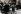 """Guerre 1939-1945. Persécution des Juifs en Pologne, le ghetto de Varsovie. Expulsion de la population juive par les unités de la SS avant le début du soulèvement. Version colorisée de la photographie extraite du rapport de 1943, """"Il n'y a plus de quartier juif résidentiel de Varsovie"""", écrit par le général SS Jürgen Stroop (1895-1952), affecté à la liquidation ultime du ghetto de Varsovie depuis la mi-avril 1943. Rapport mentionné lors de la lecture de l'acte d'accusation avant le procès de Nüremberg, le 21 novembre 1945. L'enfant aux mains levées est Tsvi Nusbaum. Varsovie (Pologne), 16 mai 1943. © Ullstein Bild/Roger-Viollet"""