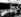 Royal Automobile Club Tourist Trophy, course automobile. L'Aston Martin de Stirling Moss après qu'elle ait pris feu. Son co-pilote Roy Salvadori fut blessé. Circuit de Goodwood (Angleterre), 5 septembre 1959. © TopFoto/Roger-Viollet