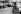 """Tournage des """"Dragueurs"""", film de Jean-Pierre Mocky. Charles Aznavour. France, février 1959. © Bernard Lipnitzki / Roger-Viollet"""